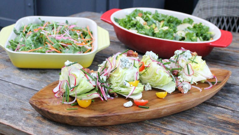 assorted salads, with a wedge salad in the foreground