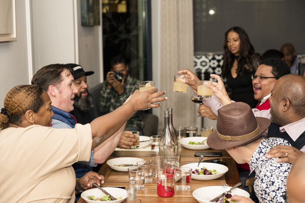 a group of people sitting at a dinner table