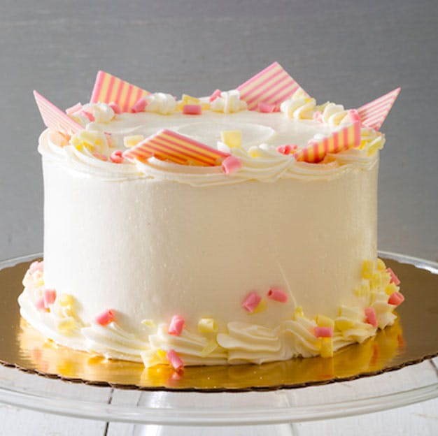 a close up of a piece of cake sitting on top of a table