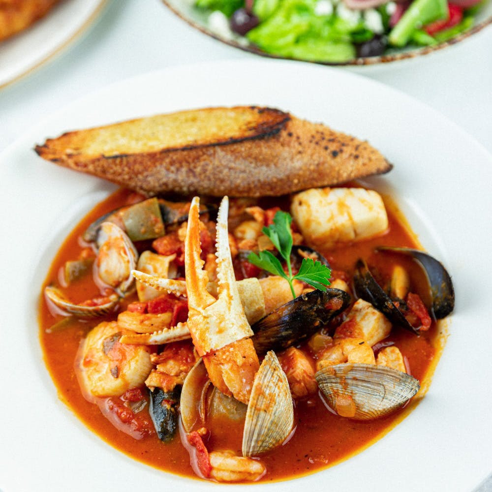 clams, mussels, crabmeat, shrimp, scallops and fish in marinara sauce