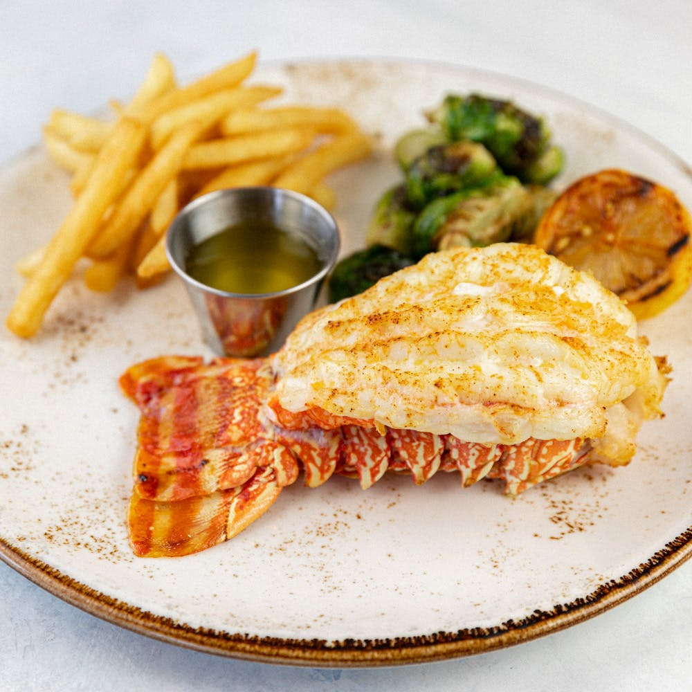 Lobster Tail, French Fries, Greens