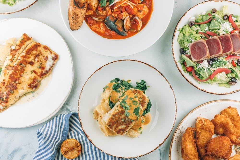 Variety of food dishes from Trout, Cioppino, Mahi Mahi, and tuna