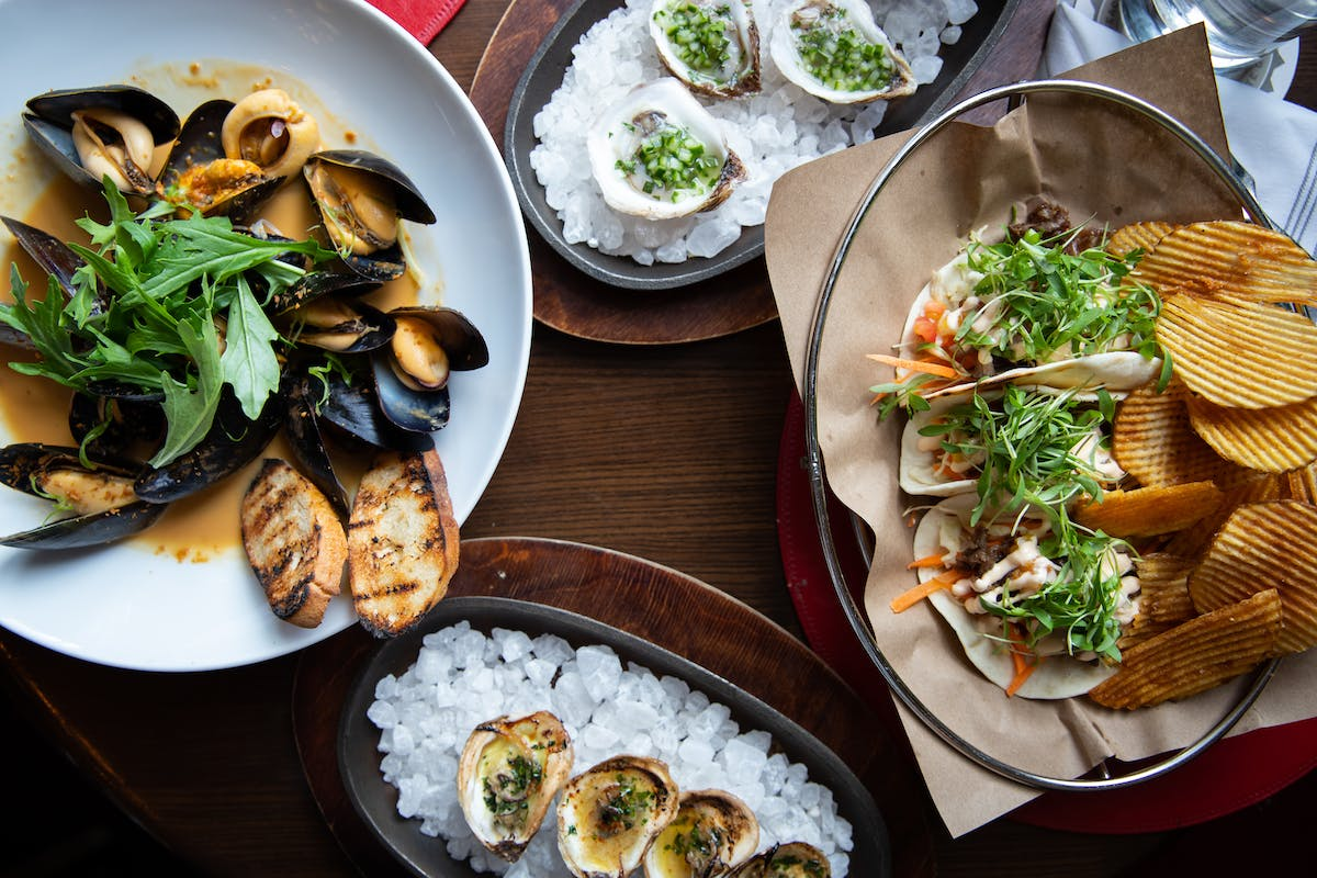 Mussels with Red Thai Curry, plus Oysters at The Tavern at American Bounty in Hyde Park, NY.