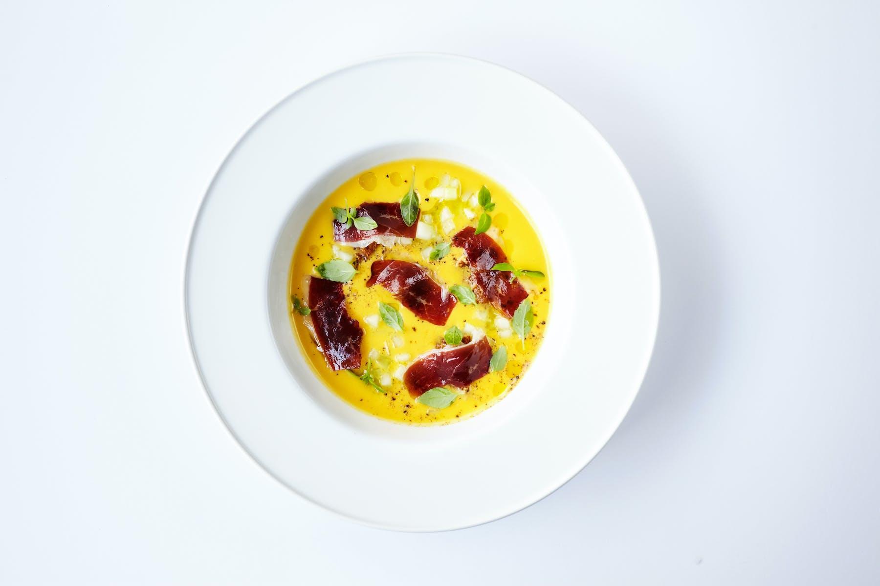 a yellow soup dish