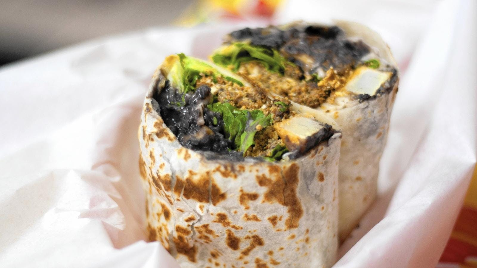 a close up of a burrito