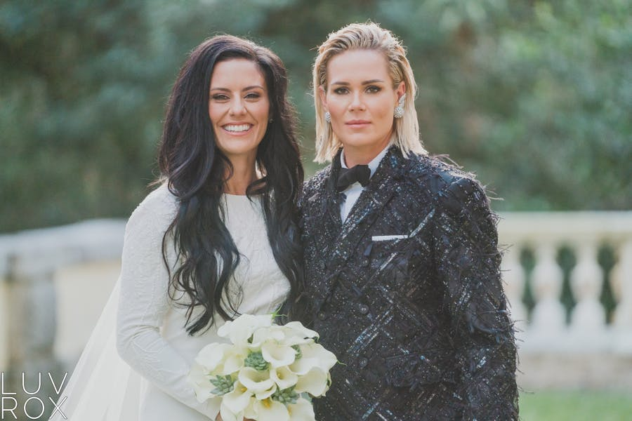 Ali Krieger, Ashlyn Harris are posing for a picture