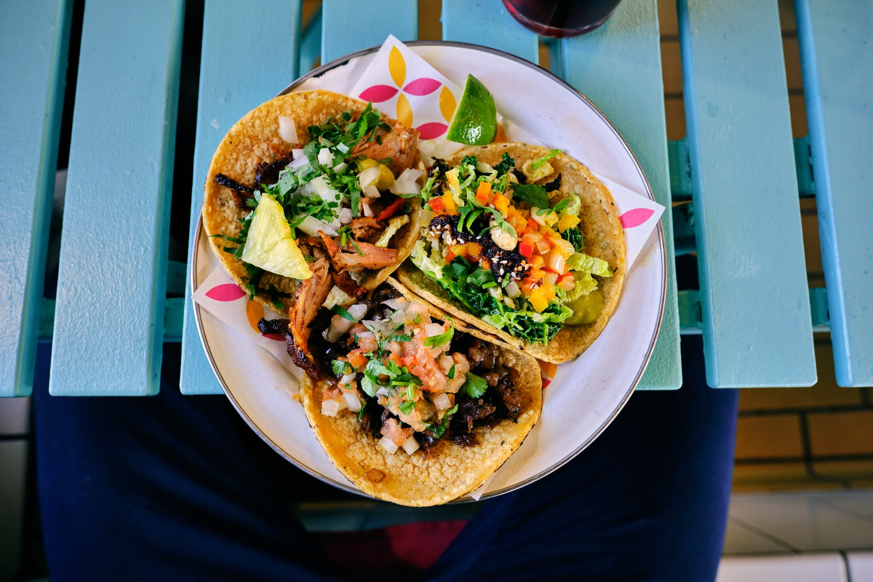 three tacos topped with greens