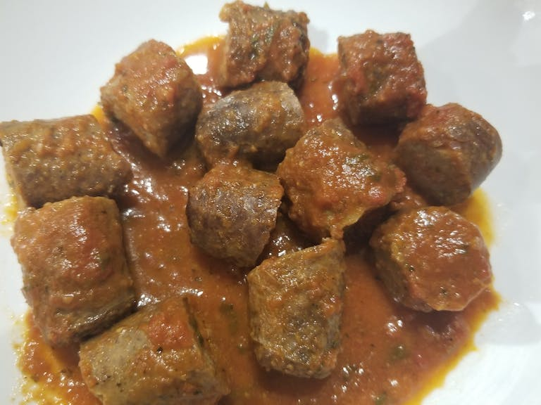 a plate of food with stew