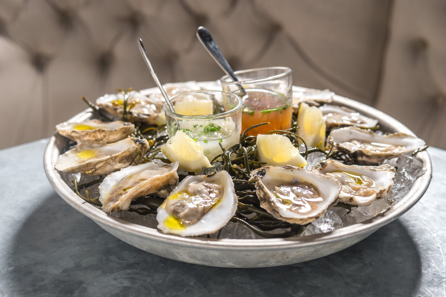 a plate of raw oysters on a table