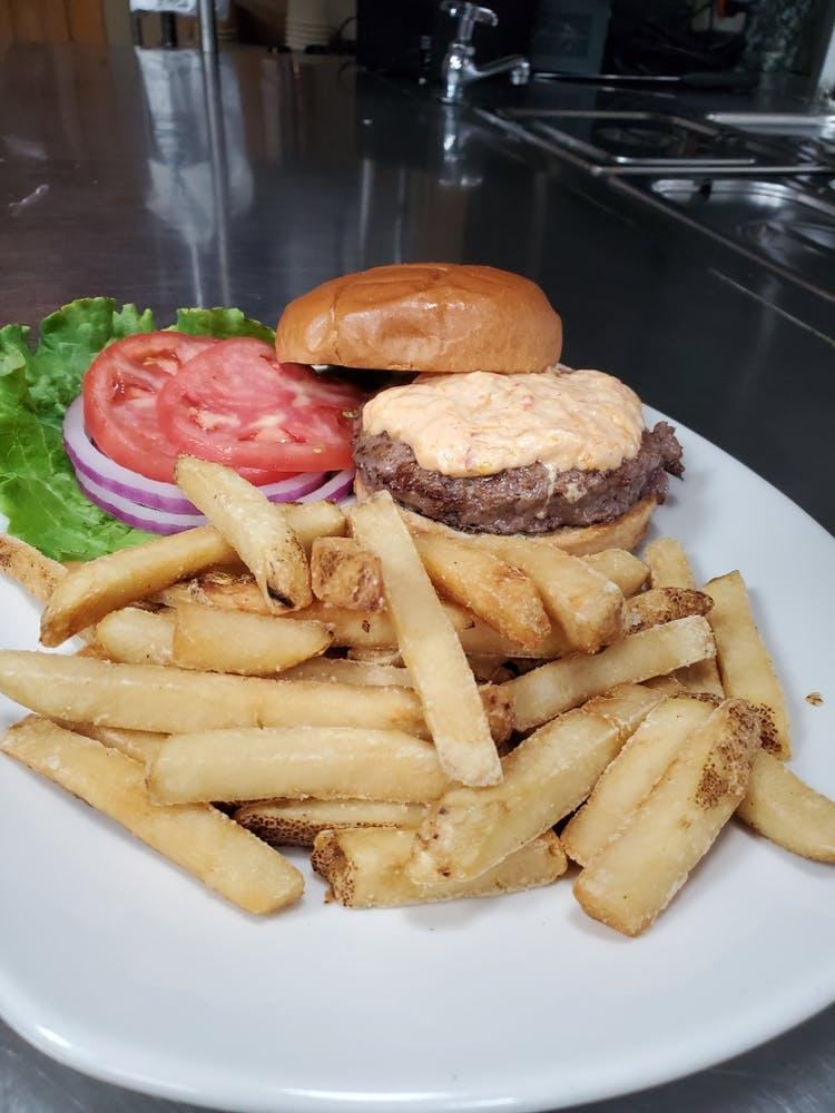 a chicken sandwich and fries on a plate