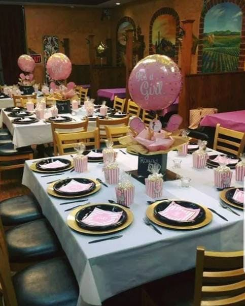 a table decorated with pink