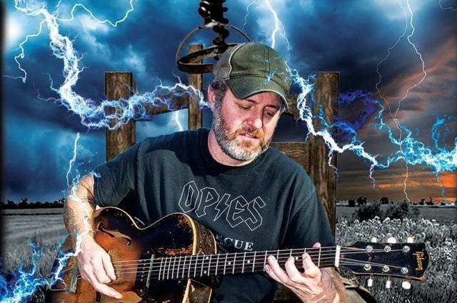 Scott H. Biram holding a guitar