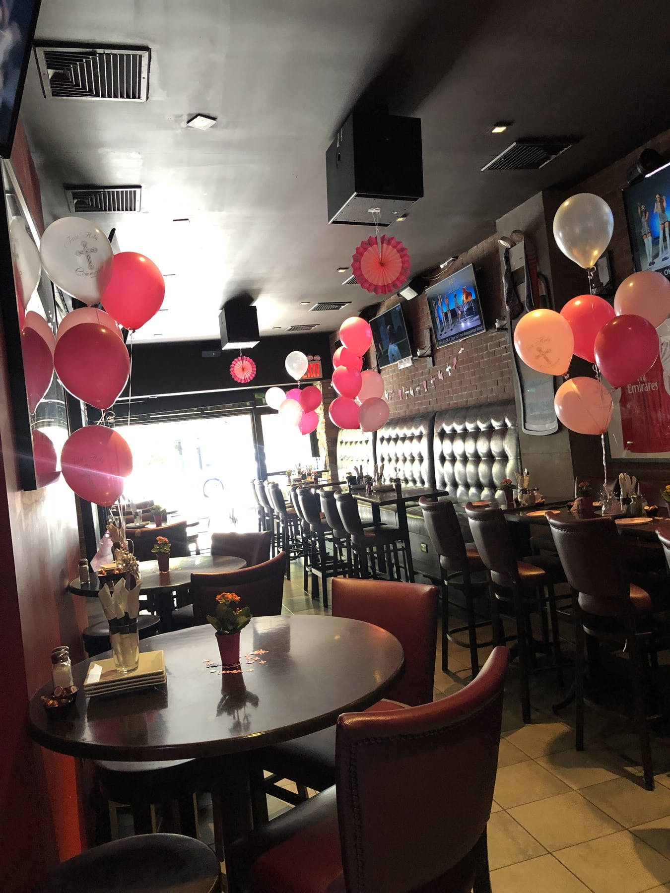 indoors decorated with balloons