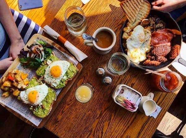a plate of food on a wooden table
