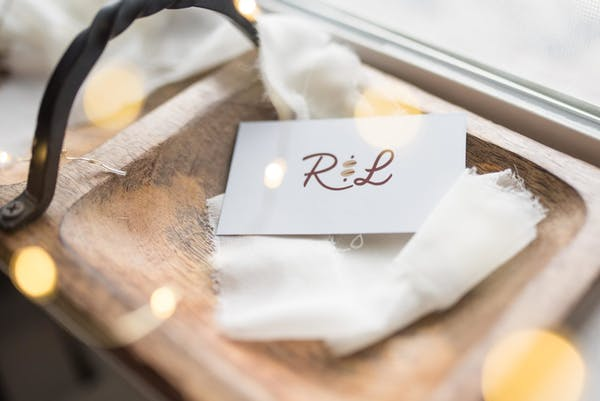 an envelope on a wooden plate