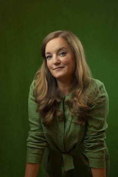 a woman wearing a green shirt
