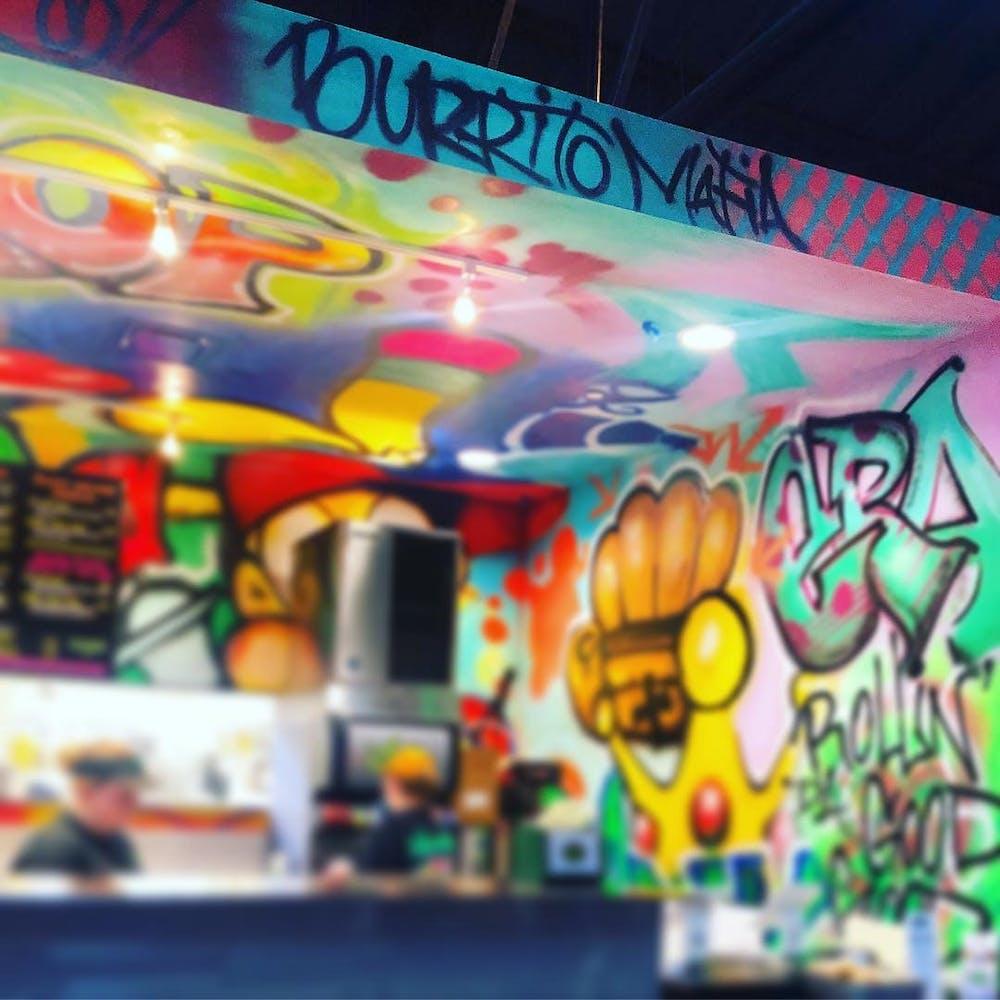 Graffiti sprayed on the wall of restaurant