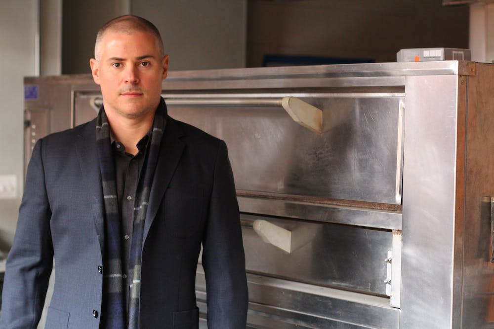 a man standing in front of a refrigerator