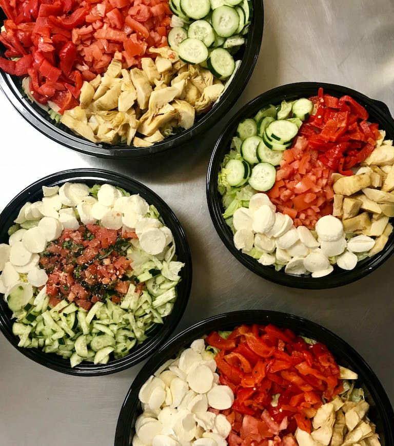 a bowl filled with different types of food on a table