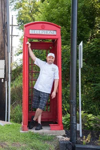 Philip Ferro owner & executive chef in a telephone booth
