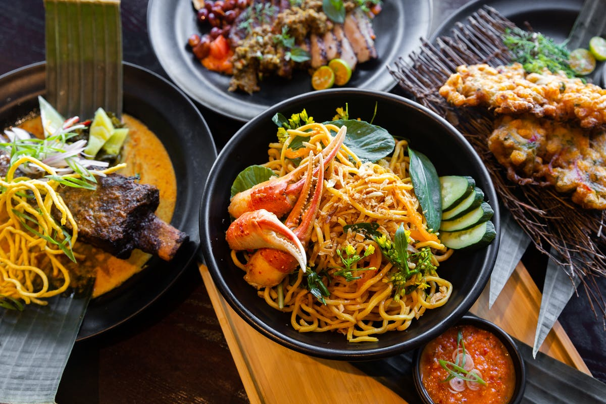 bowls and plates of modern indonesian food