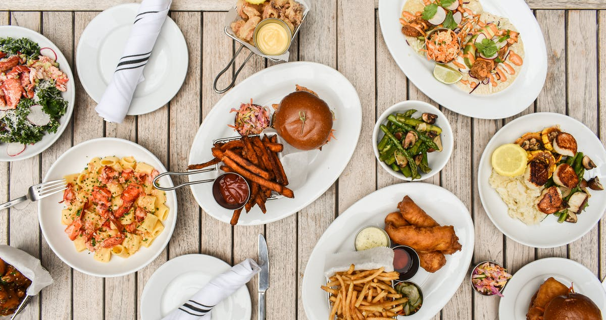 a plate is filled with different types of food on a table