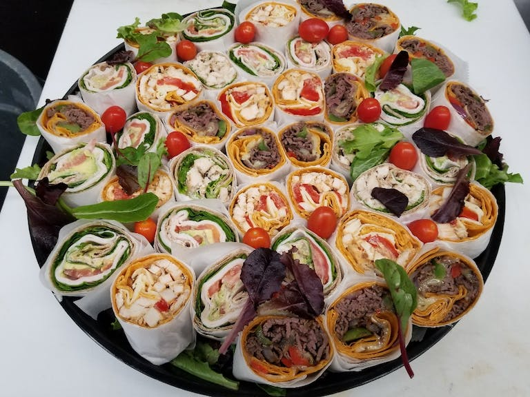 a meal of pizza and salad on a plate