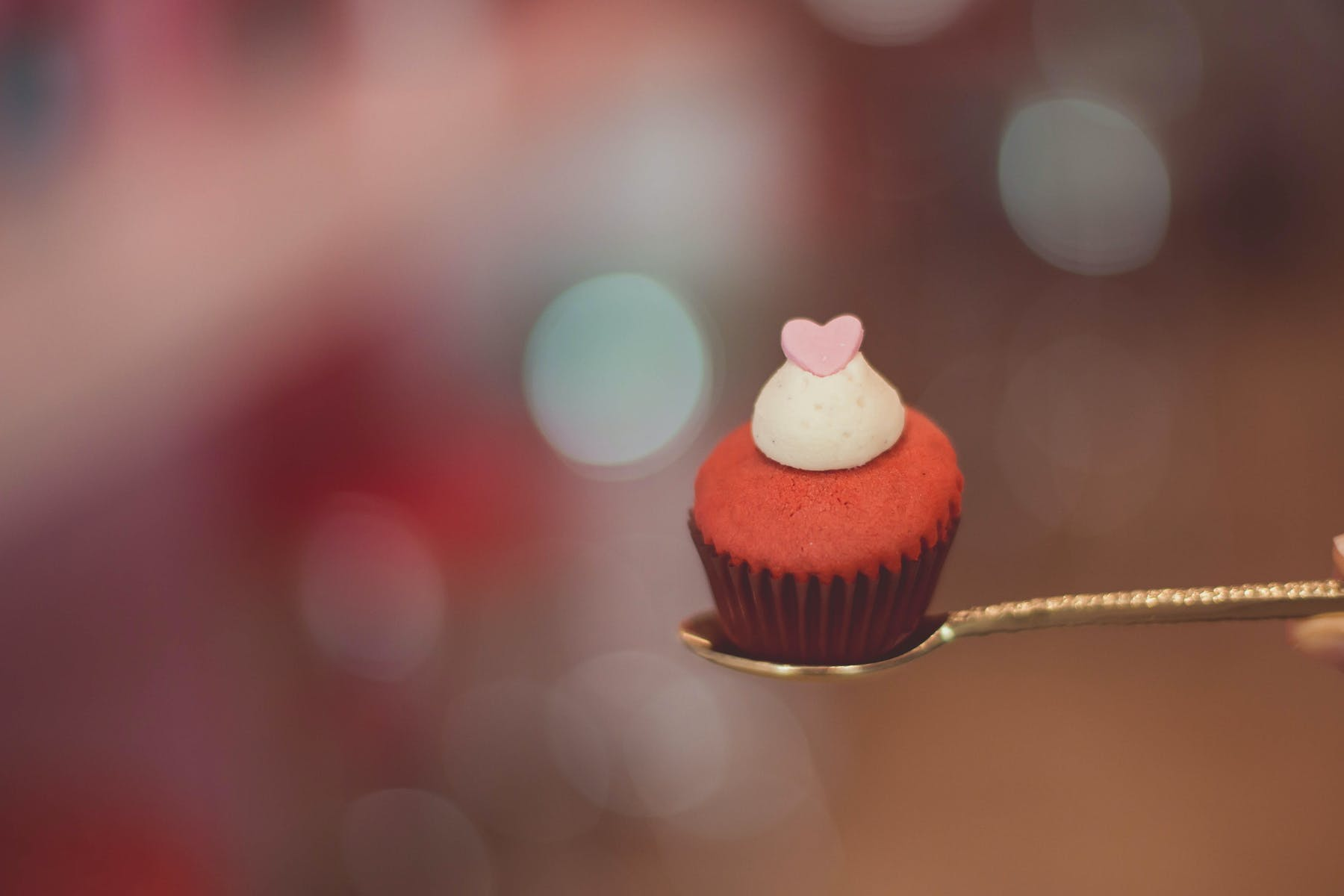 a cupcake sitting on a spoon