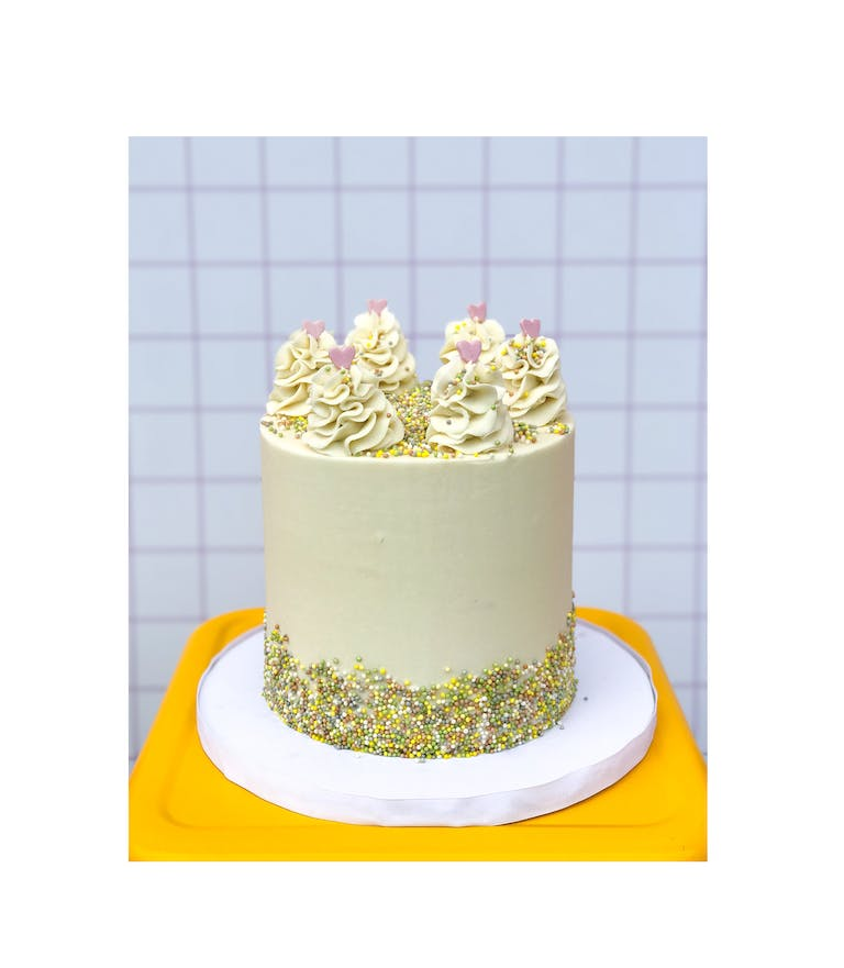 a yellow and white cake