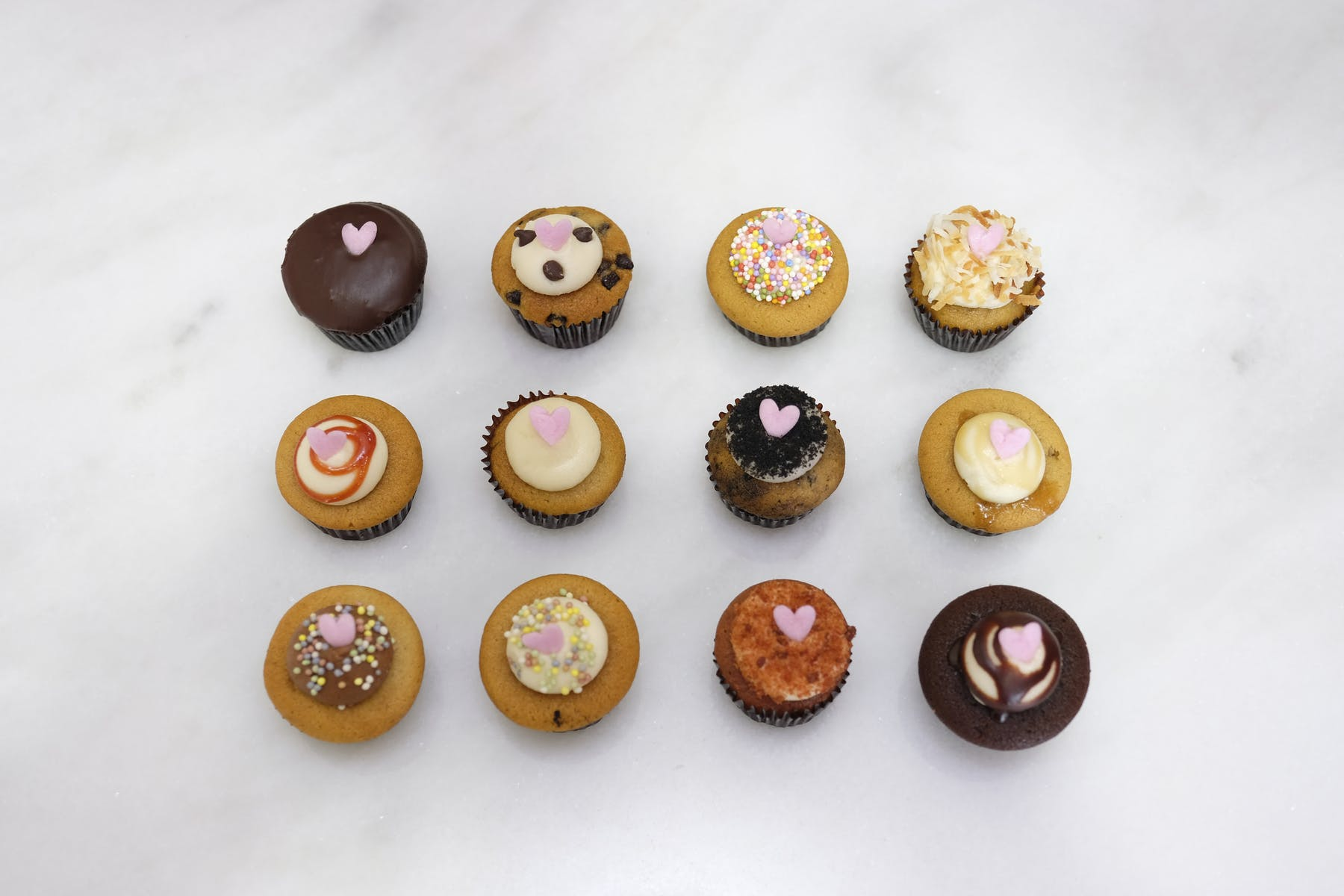 a bunch of different types of donuts