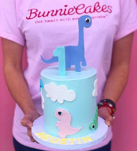 a person standing in front of a birthday cake