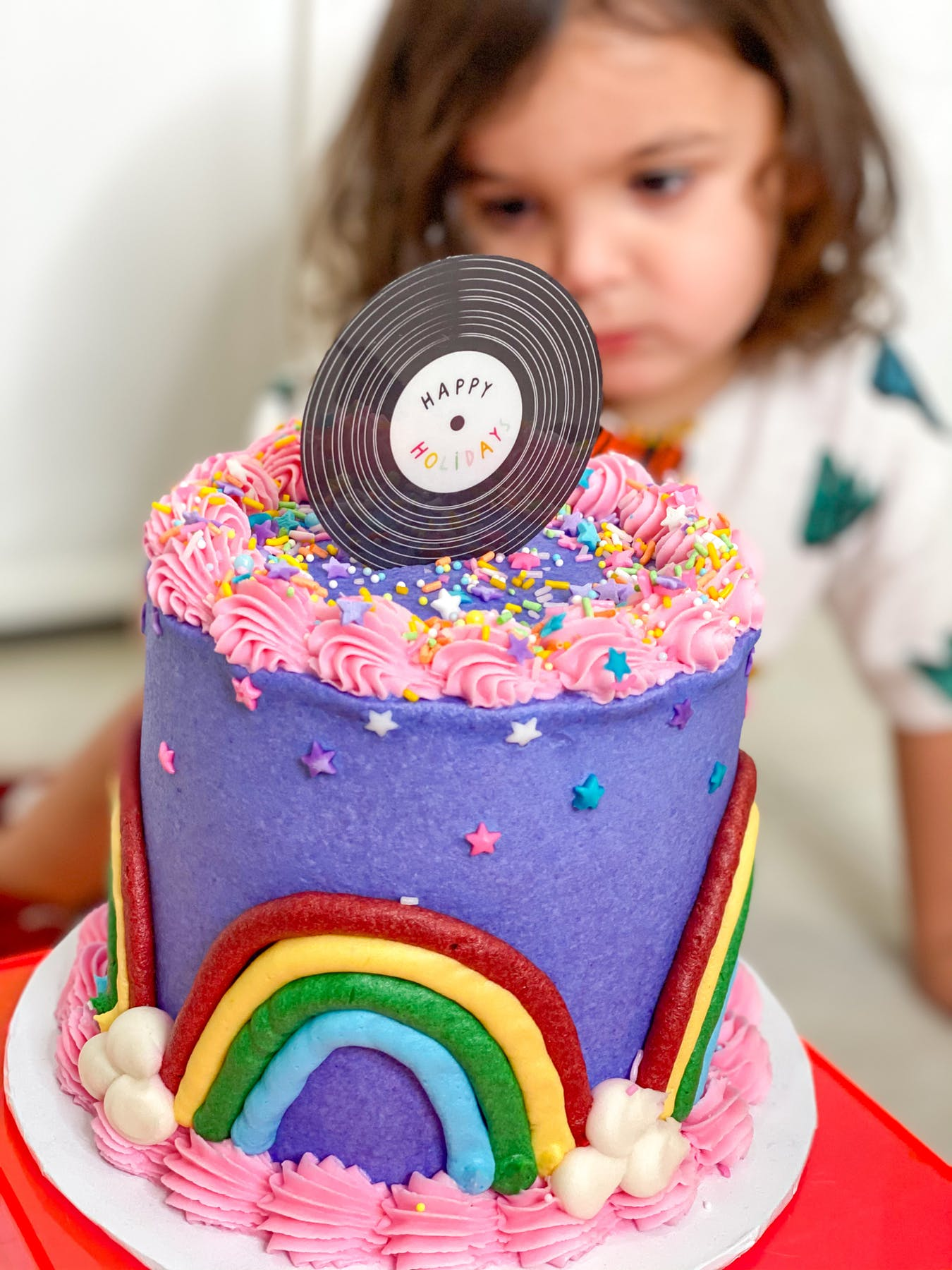 a person holding a birthday cake