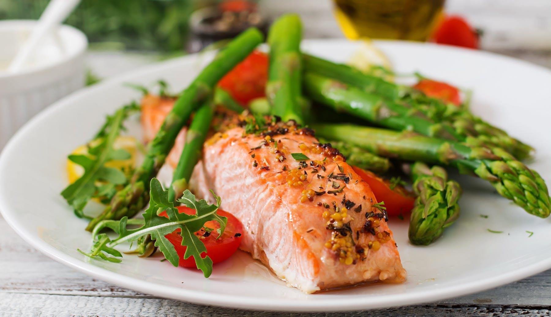 salmon with asparagus on a plate