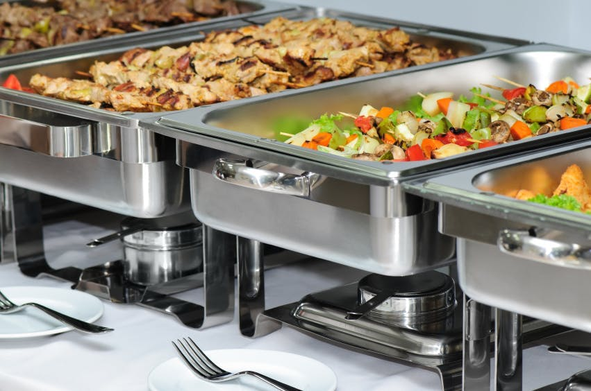 aluminum food containers with food on them