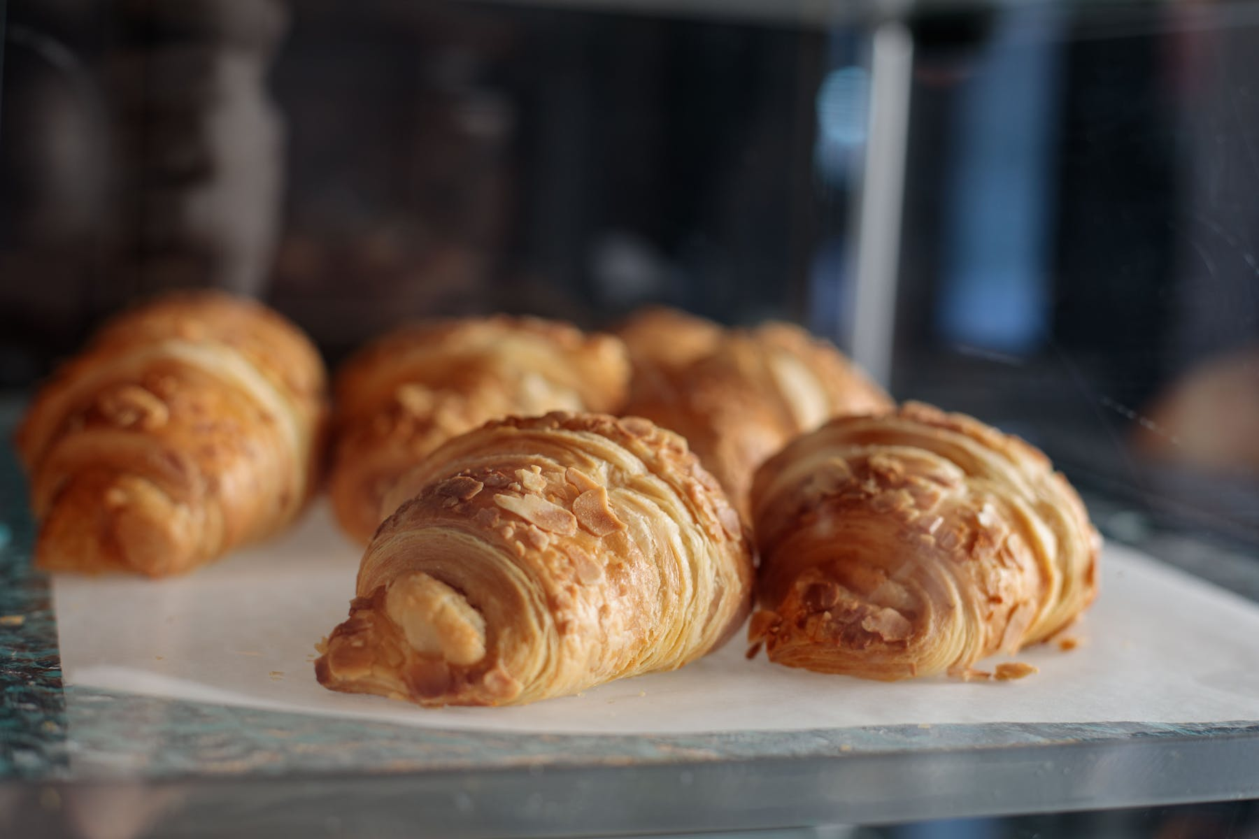 croissant in a glass display case