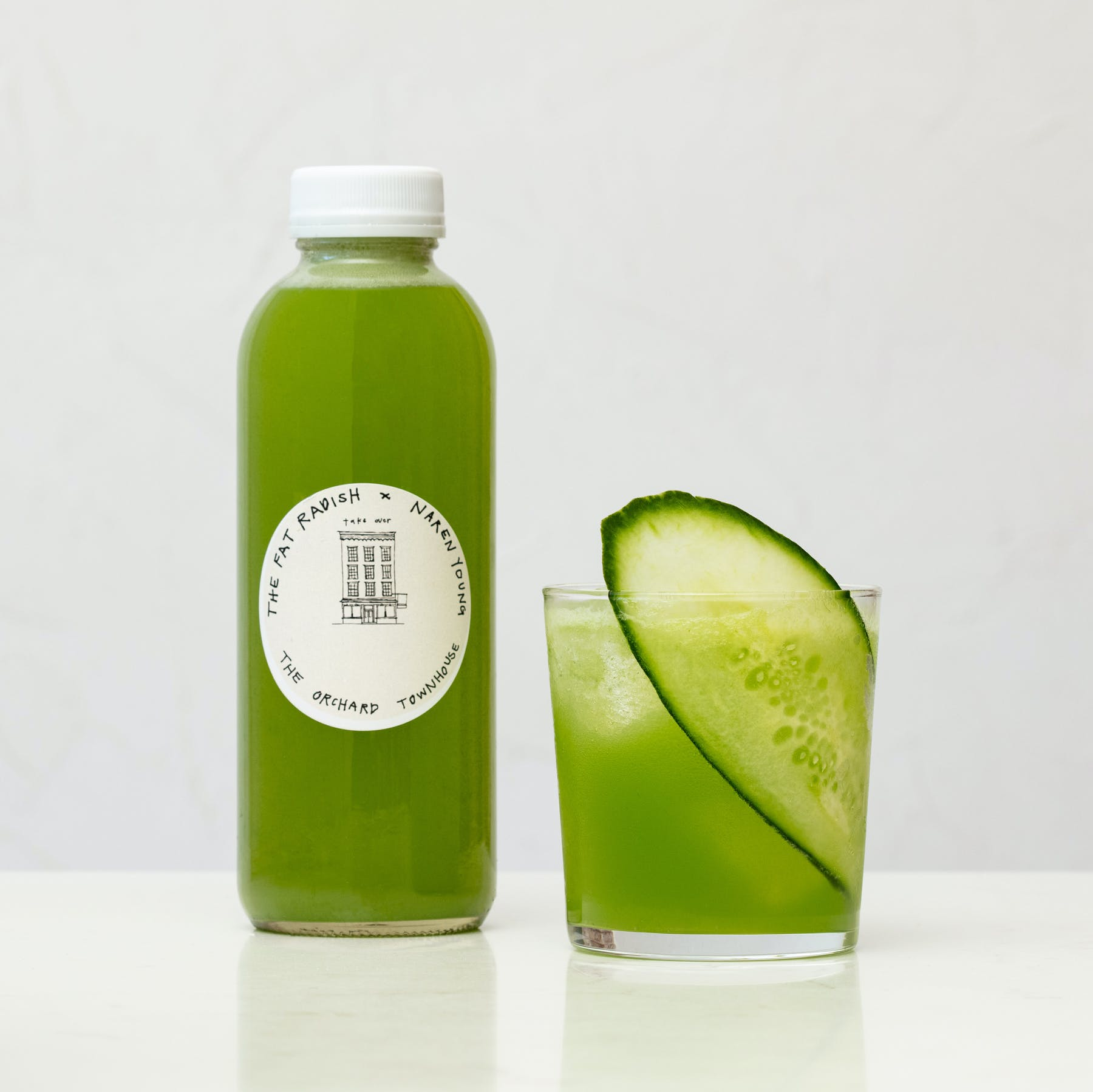a green bottle on a table