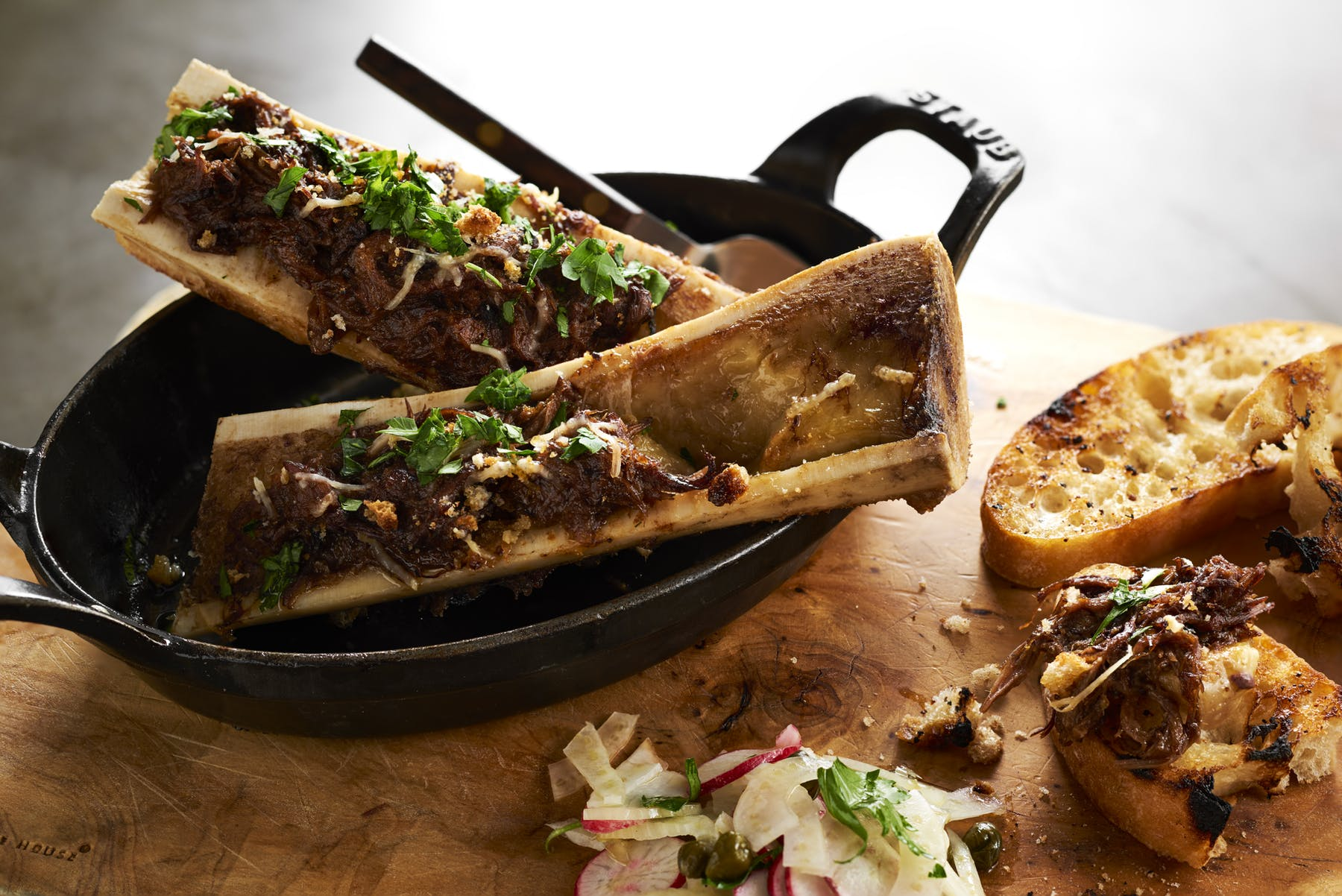 bone marrow dish in a cast iron skillet