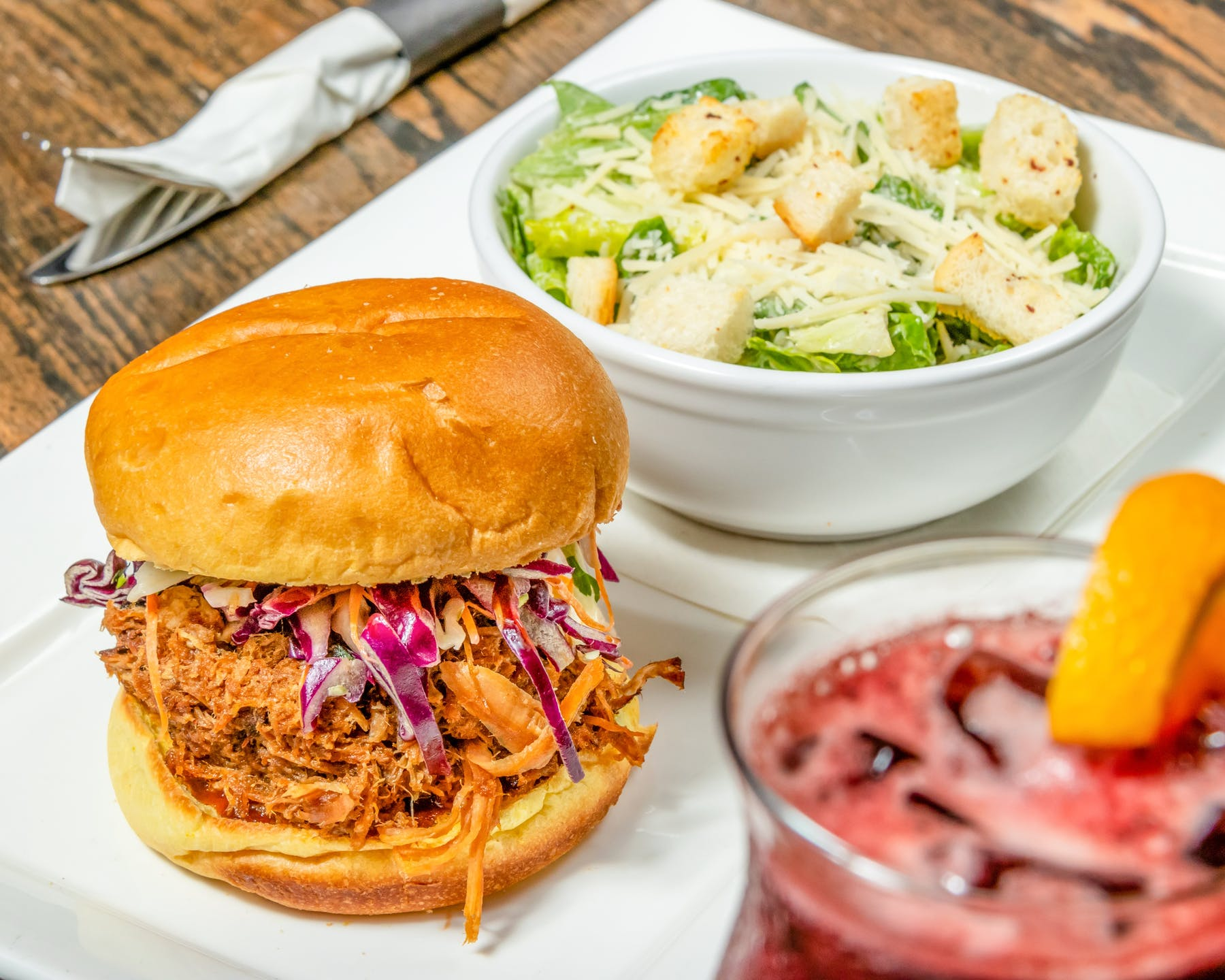 pulled pork with Caesar salad and cocktail