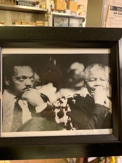 Nelson Mandela et al. in front of a window