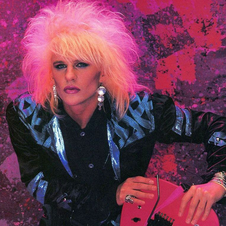 C.C. DeVille with pink hair taking a selfie