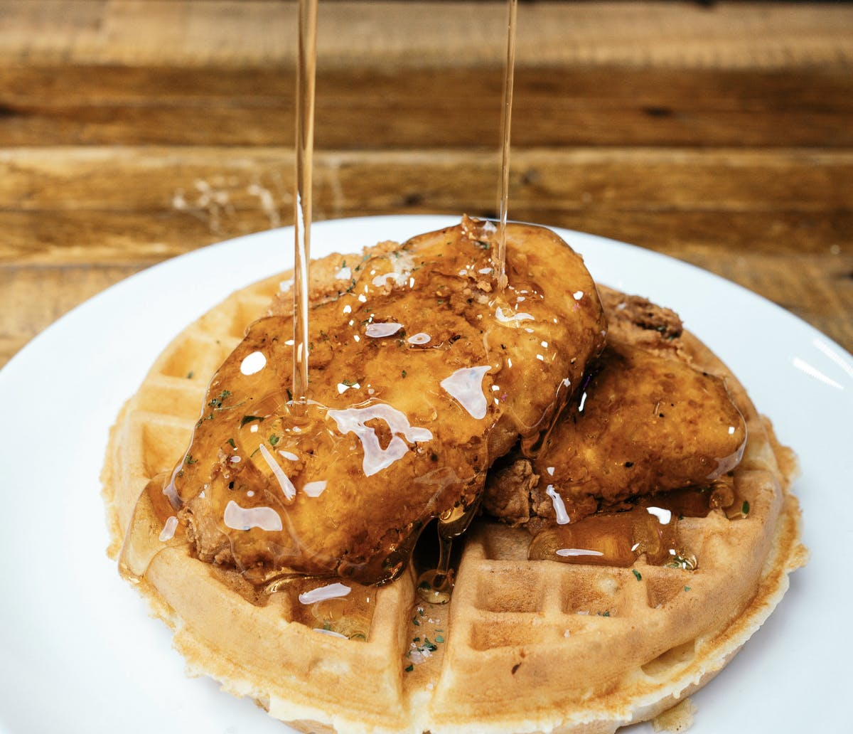 chicken and waffles with syrup pour