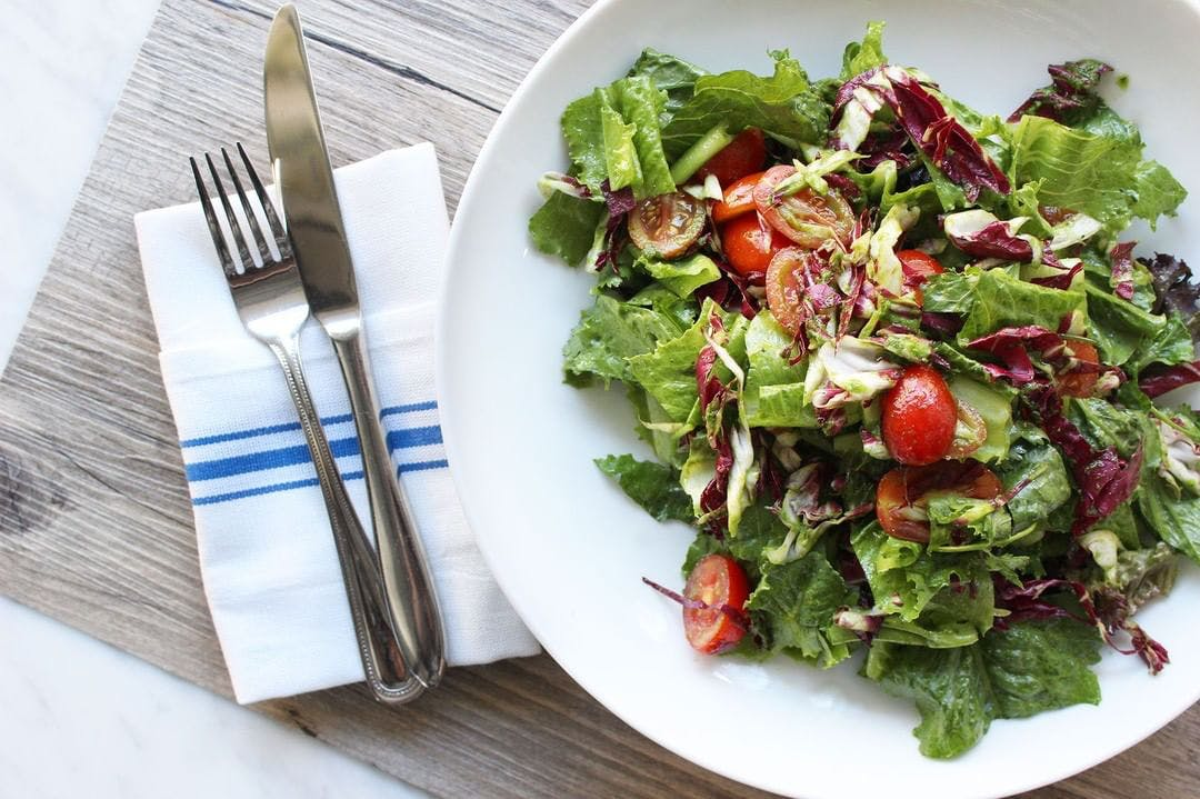 a plate of salad on a table