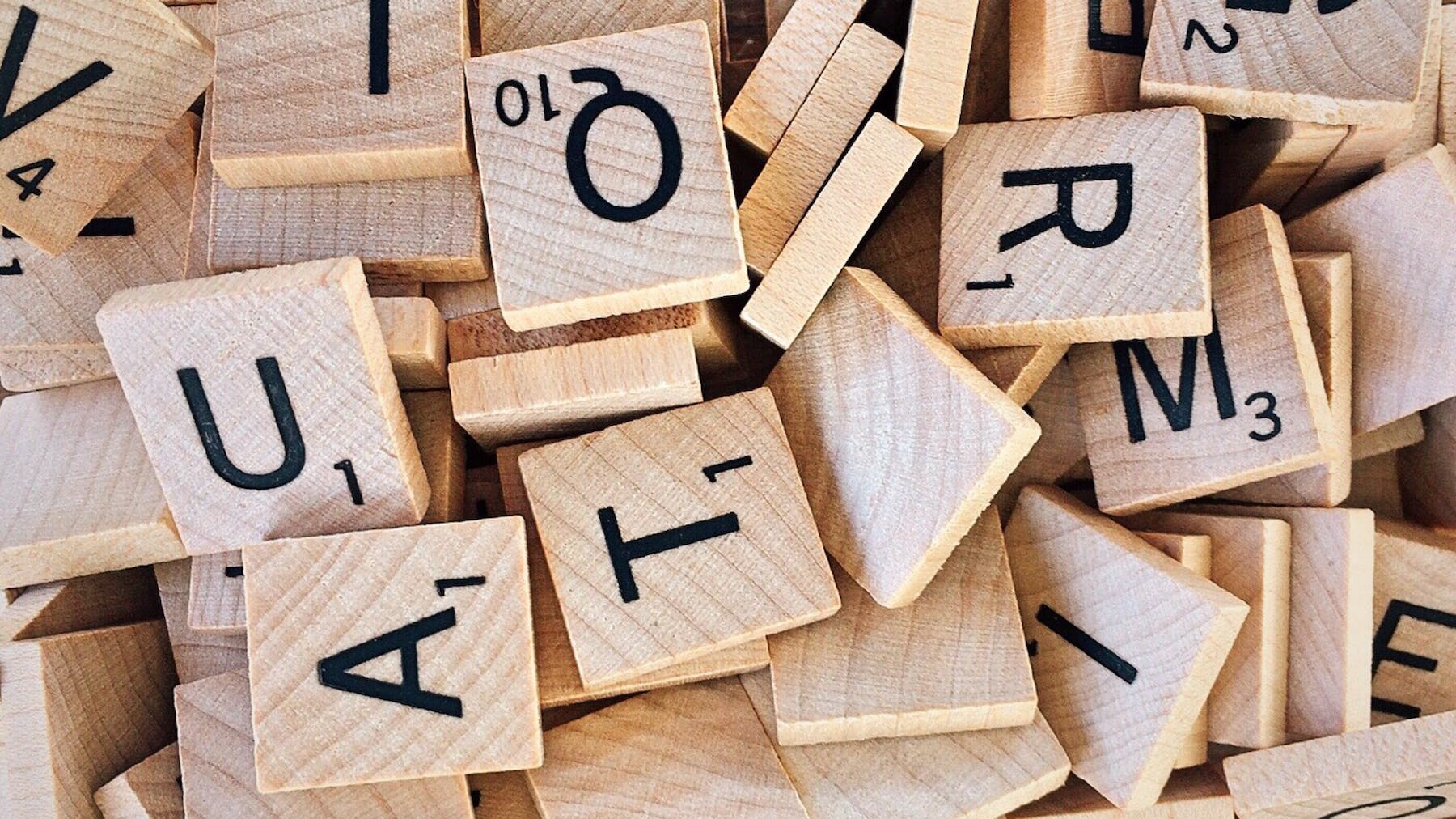 scrabble wooden letters scattered