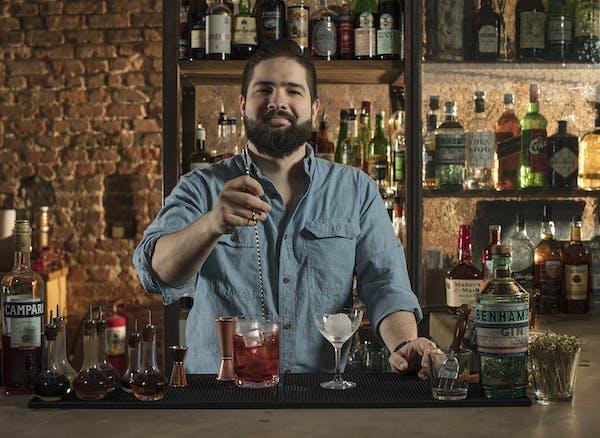 A man stirring a drink
