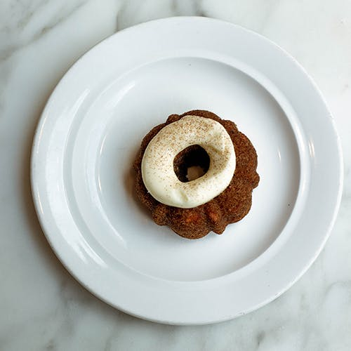 a small doughnut on a plate