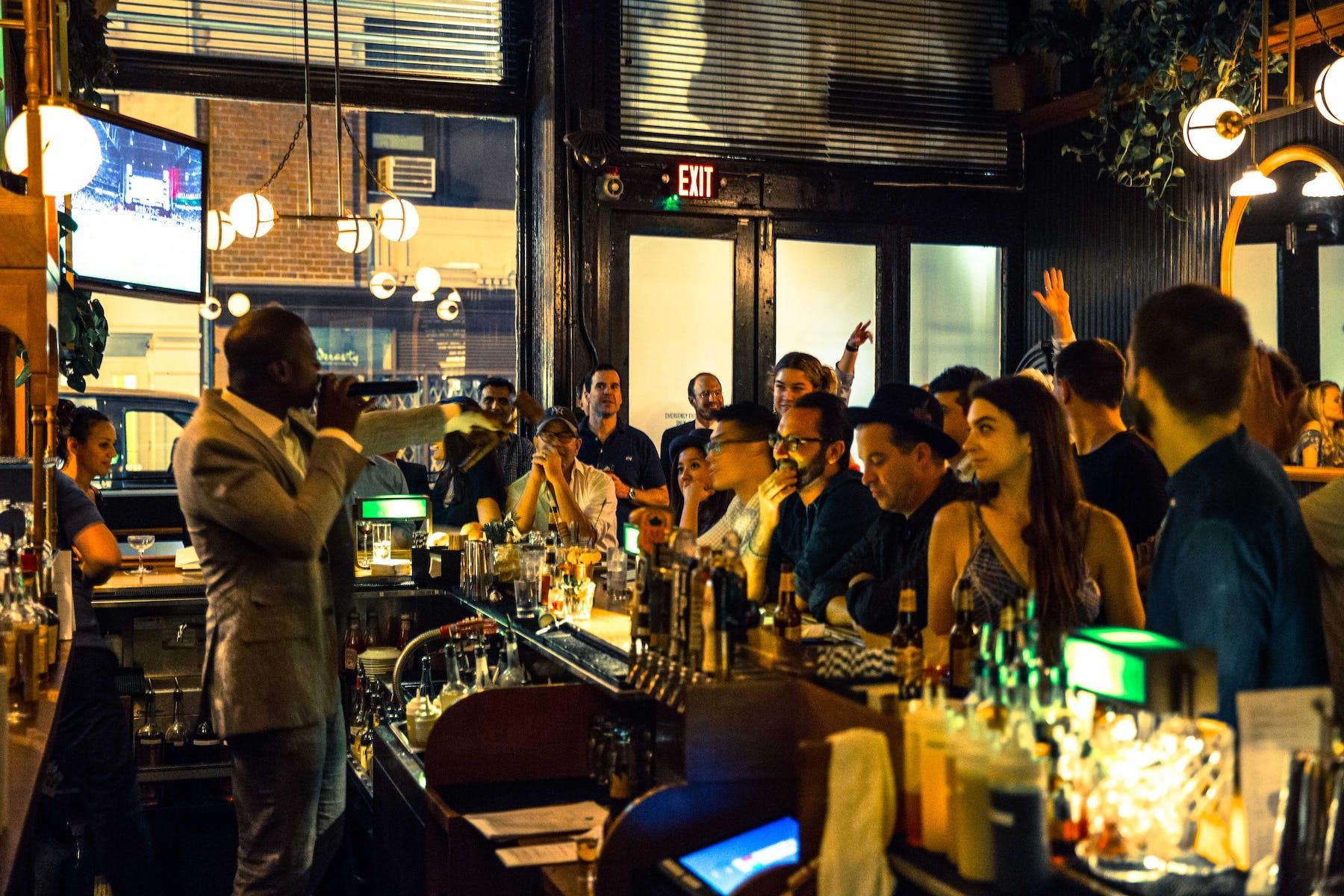 Announcer behind the bar