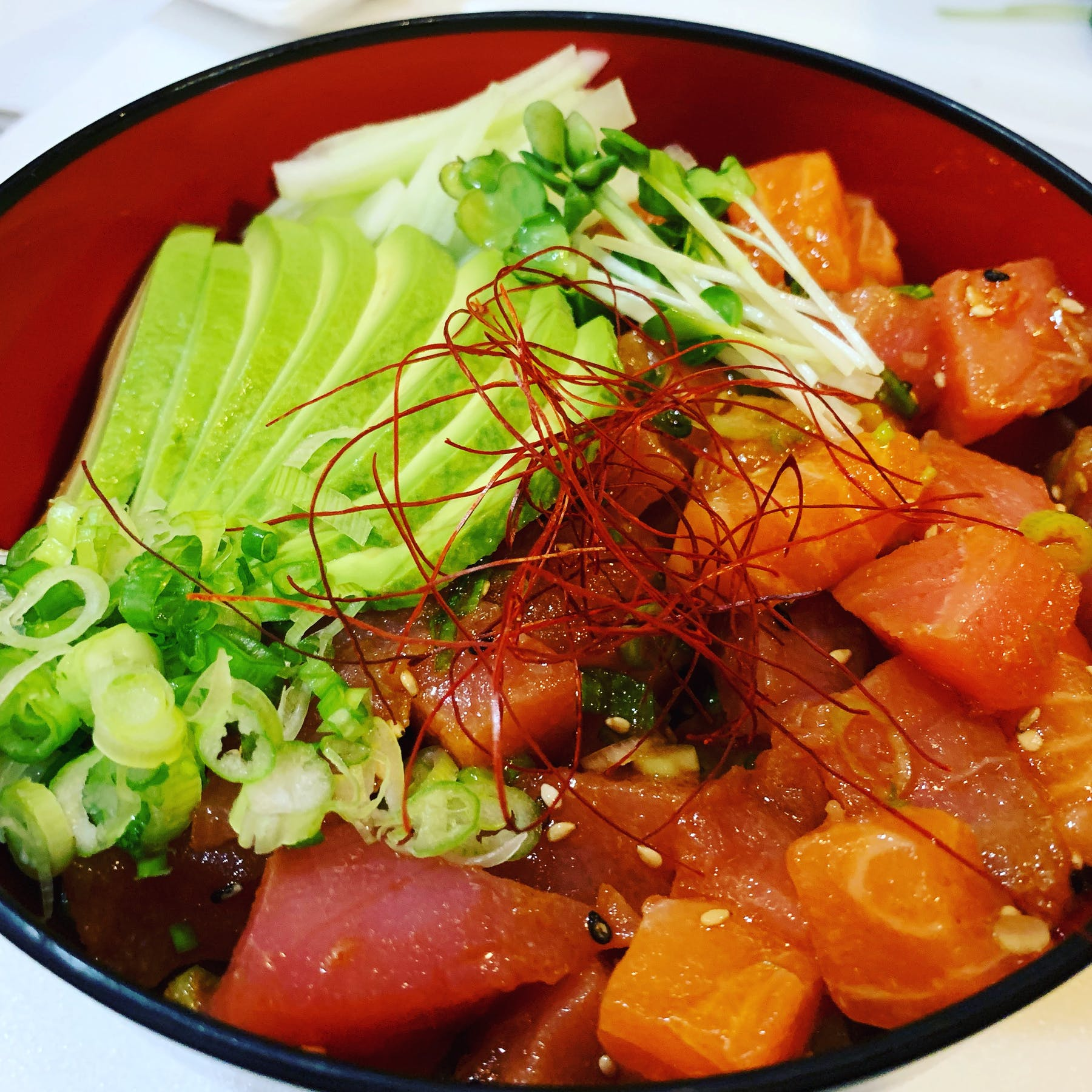 a bowl filled with meat and vegetables on a plate