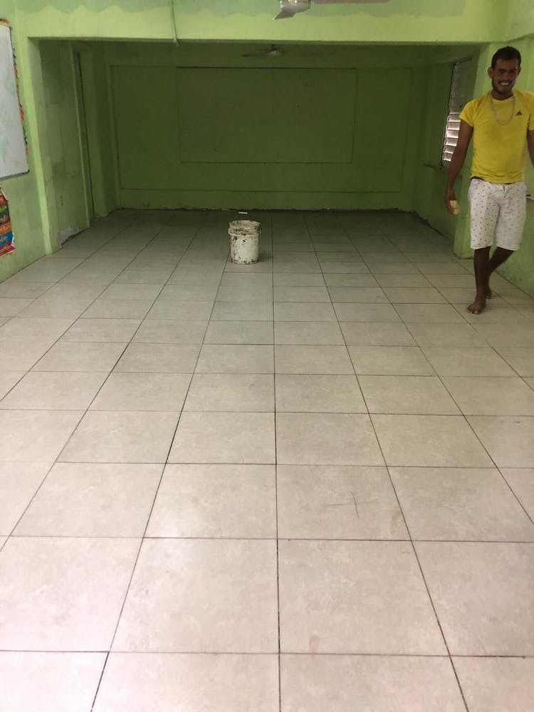 a person standing on a tile floor