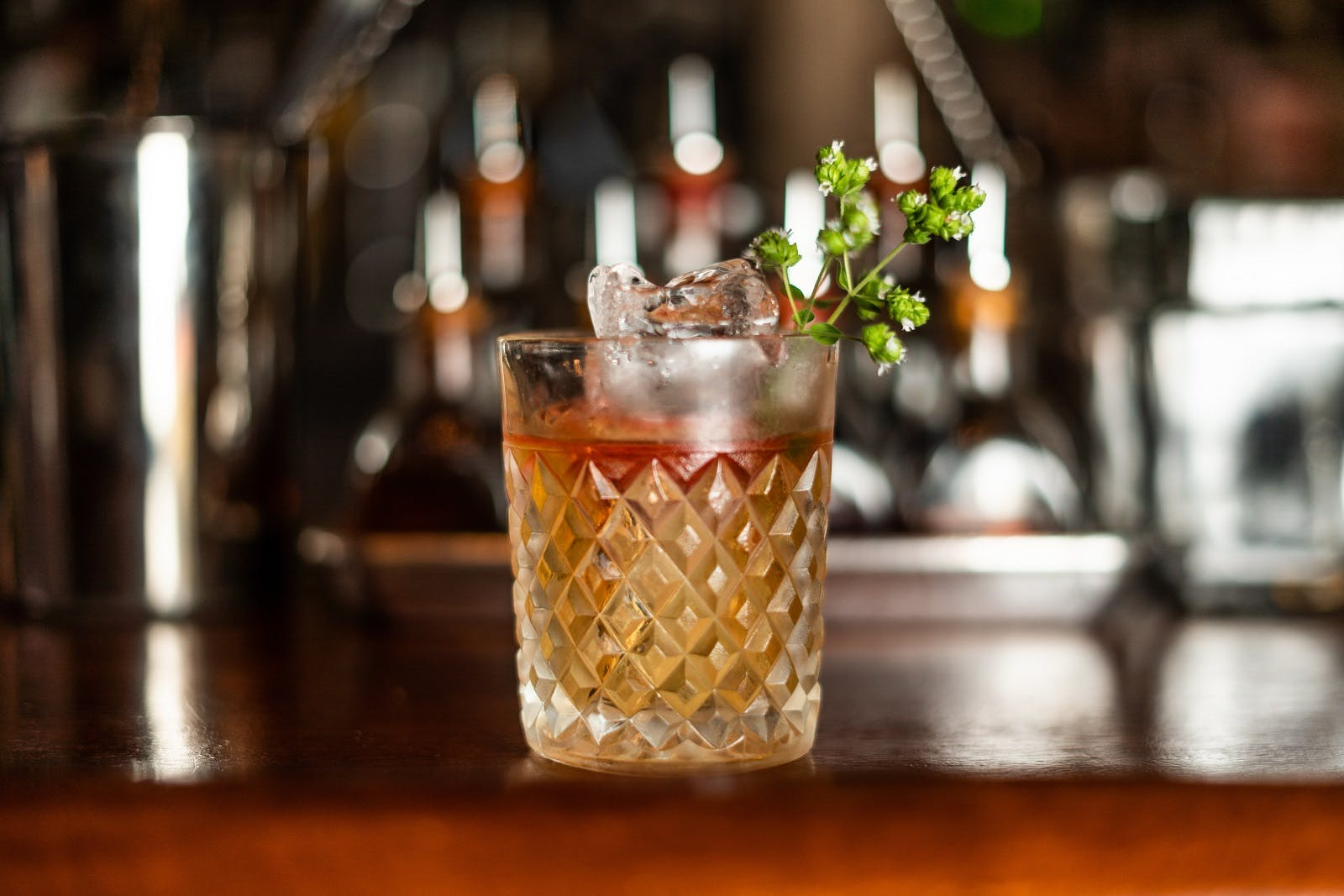a close up of a cocktail sitting on top of a wooden table