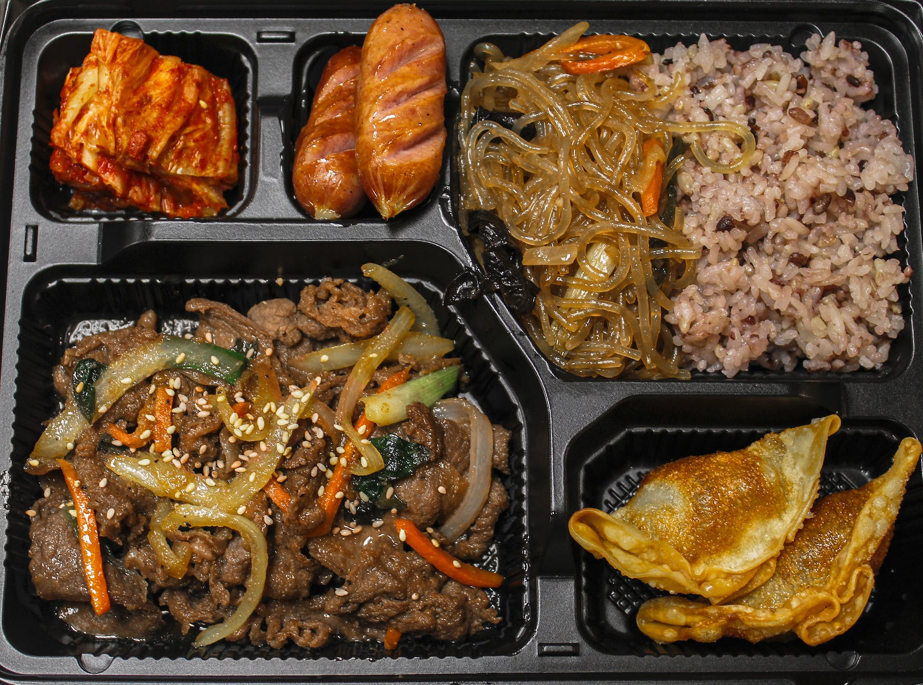a tray of food on a grill